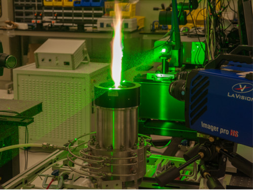 A green laser and camera system are used to do scattering measurements in a turbulent sooting flame.