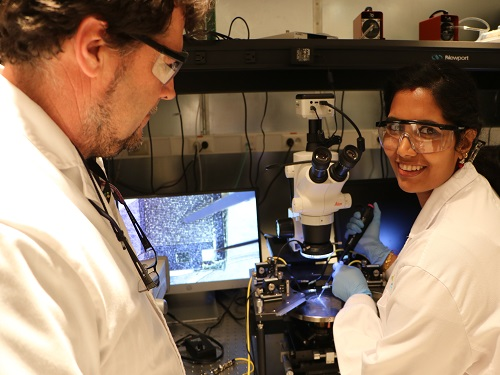 Shilpa Sivashankar and Ulrich Buttner depositing CRP on their biosensor chip and testing it under the microscope using an electrical probe station.