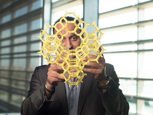 KAUST's Mohamed Eddaoudi shows off a model MOF at the University.