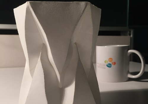 A freestanding folded structure, made from a single sheet of paper, demonstrates the software's applications.