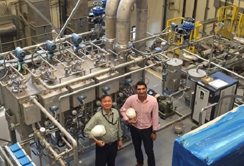 Kim Choon Ng and Muhammad Wakil inspect the MEDAD hybrid desalination pilot at KAUST.