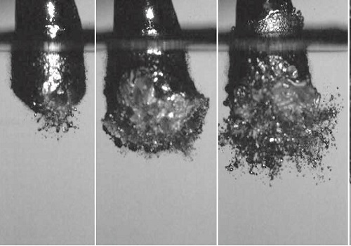 Vapor explosion of an 8 mm diameter drop of liquid Field's metal as it falls into a pool of water.