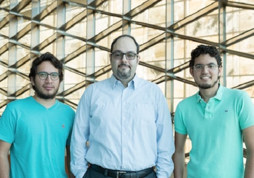 Ph.D. students Fabian Caba (left) and Victor Escorcia (right)  are working with Bernard Ghanem (center) to automate visual recognition technology.