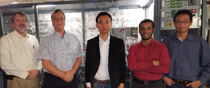 L-R: Gary Provost and Gary Tompa from Structural Materials Industries (SMI), Xiaohang Li (principal investigator), Hamad Alotaibi (undergraduate intern from King Fahd University of Petroleum and Minerals), and Kuang-Hui Li (first author) in front of a MOCVD prototype in a workshop at SMI.