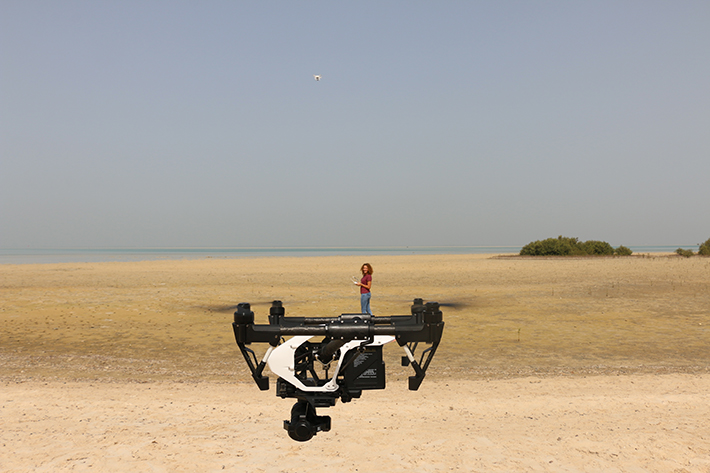 Cecilia Martin flying the drone she uses to survey plastic pollution on the shores of the Red Sea.