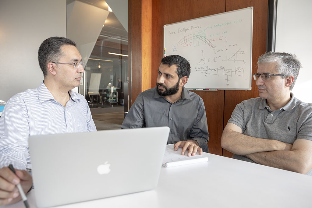 Tareq Al-Naffouri, Nasir Saeed and Mohamed-Slim Alouini (l-r) discuss how their system helps move toward the Internet of underwater things.