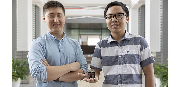 Students Azamat Bakytbekov (left) and Thang Nguyen helped to develop a cube-shaped energy harvester that can gather power from a nearby smartphone.
