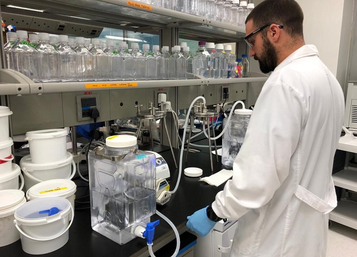Luis Silva sets up the filtration system in the laboratory at KAUST to remove protistan grazers.
