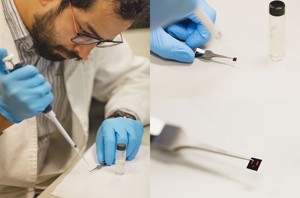 Nitin Batra prepares a sample of nanowires to analyze using the NMR.
