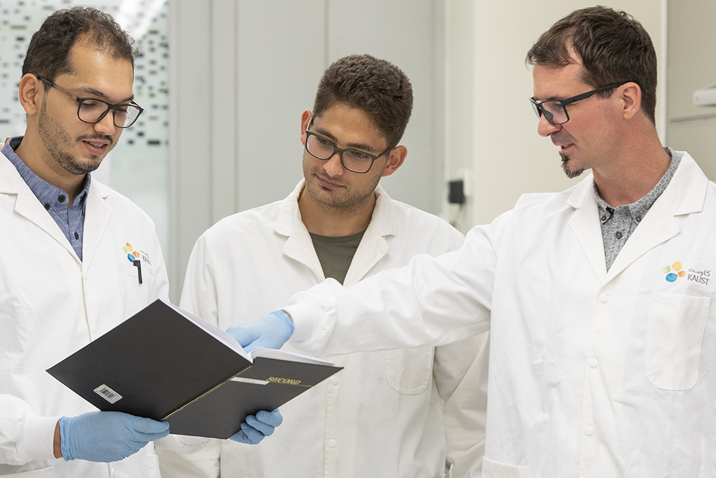 (l-r) Abdullah Almansouri, Liam Swanepole and Jurgen Kosel discuss the results of their tests on the magnetic skin.