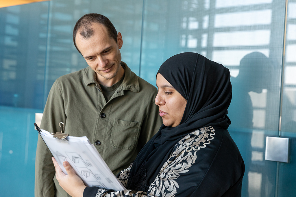 Robert Hoehndorf (left) and Sara Althubaiti discuss the performance of their algorithm.