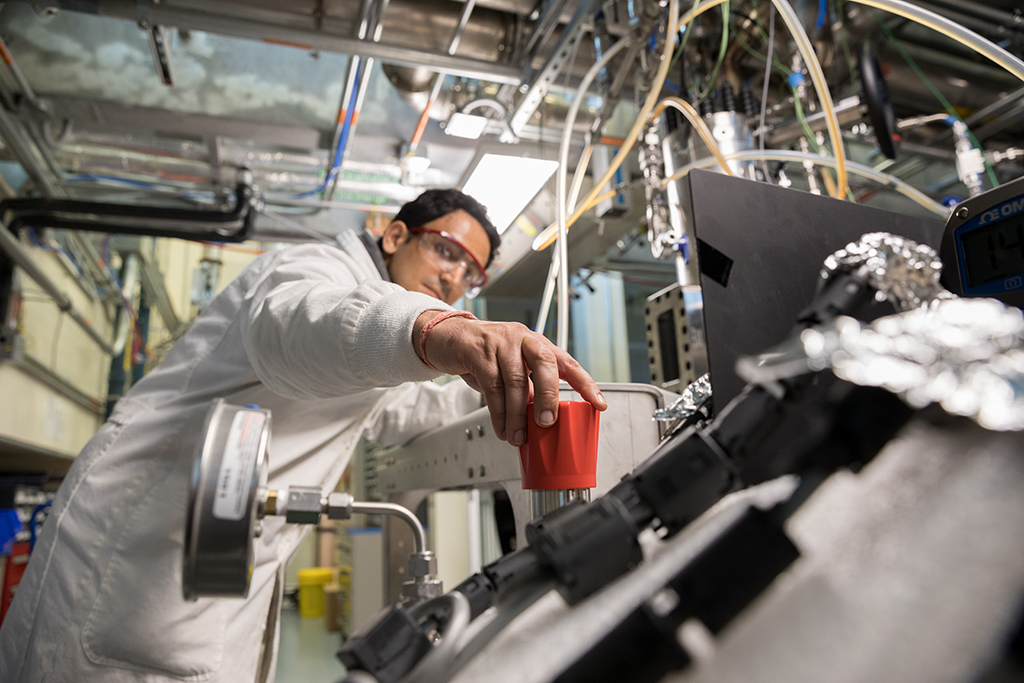 A postdoc in Deanna Lacoste's group Amit Katoch adjusts the flow of nitrogen into the system.