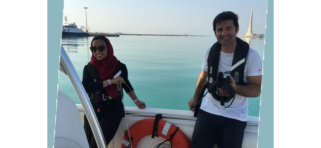 Eman Sabbagh and Miguel Viegas measure temperature and salinity after collecting the weekly surface water sample from KAUST Harbor.