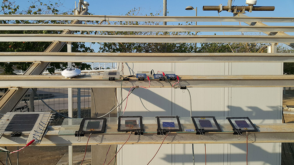 Encapsulated perovskite/silicon tandem solar cells  under testing at a KAUST outdoor test facility.