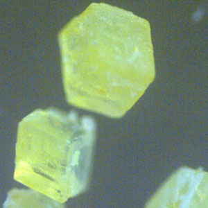 Missing atoms in a forgotten crystal bring luminescence
